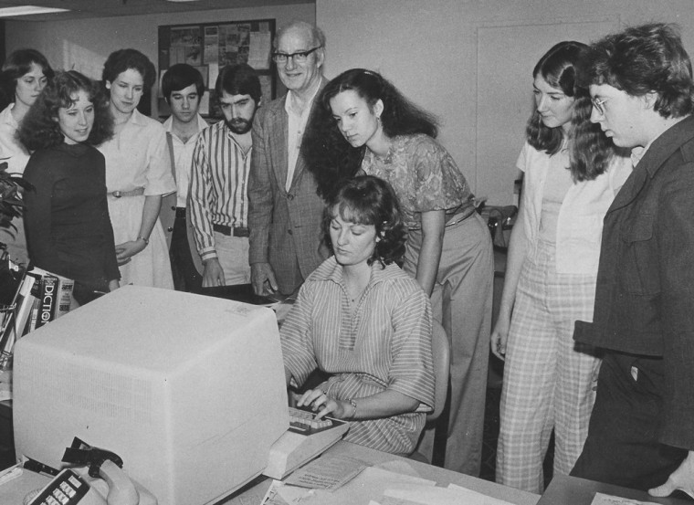 "Members of my journalism class at the University of Washington visit a newspaper in the early 80s (note the gigantic computer). I'm second from the left. To my right is my roommate at the time, Helen Grieve, and standing far right is Author Charles R. Cross. Our professor was the late great William ""BJ"" Johnston."